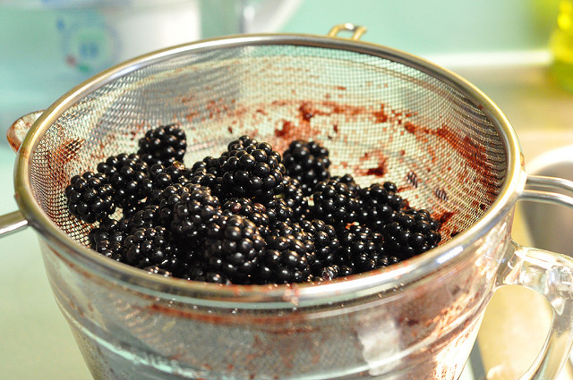 blackberries in strainer