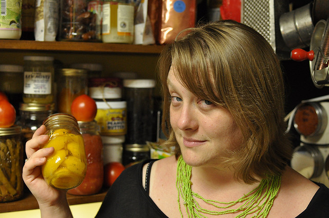 me, holding a jar of peaches