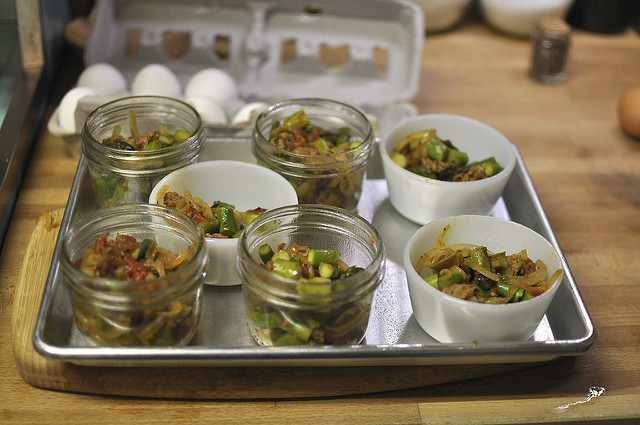 cups/jars with sauteed vegetables