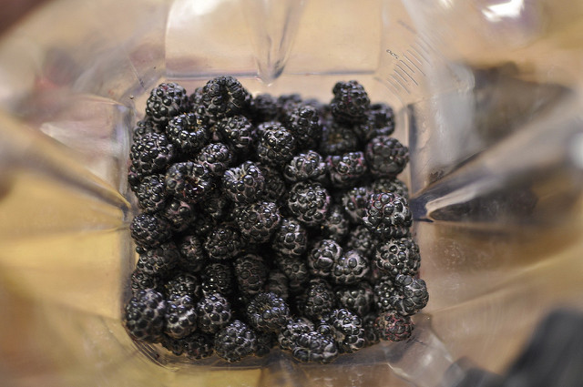 three cups black raspberries in the vitamix