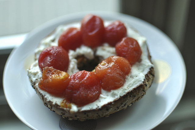 bagel with goat cheese and pickled tomatoes
