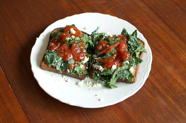 greens, ricotta and tomato jam on toast