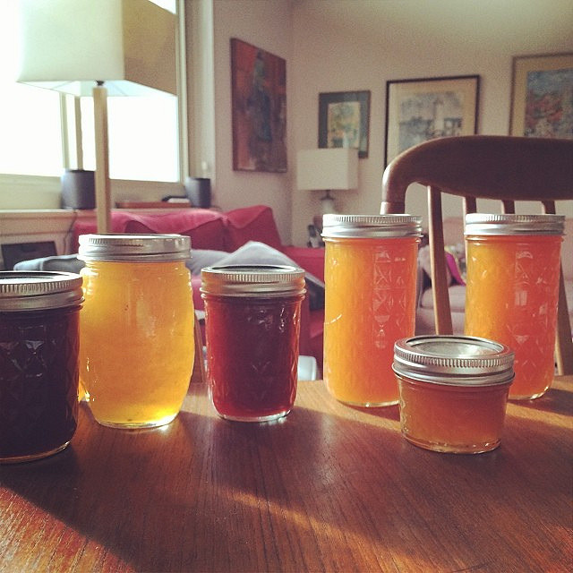 Jars of jams and jellies on the table.