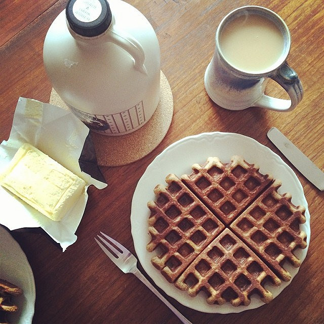 Waffles, fancy butter and maple syrup.