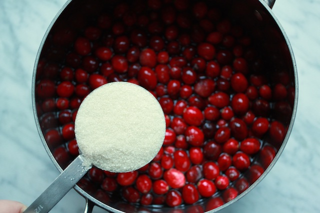 adding sugar to cranberries