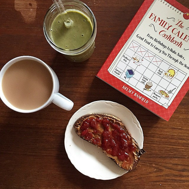 Almond butter toast, tea, a strawberry/banana/spinach smoothie, and a cookbook.