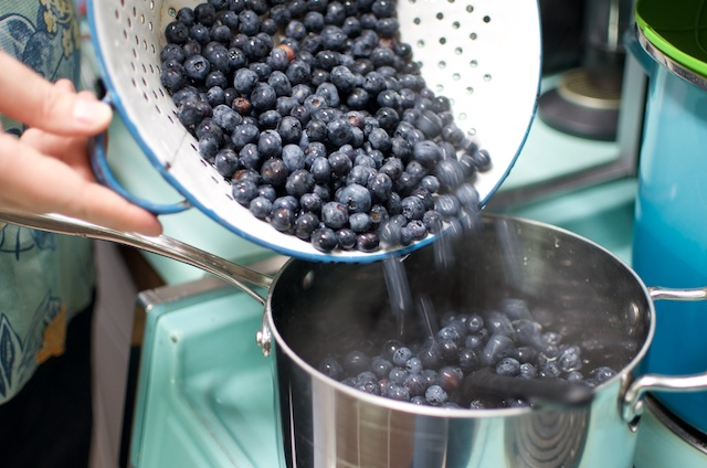 pouring berries into colander