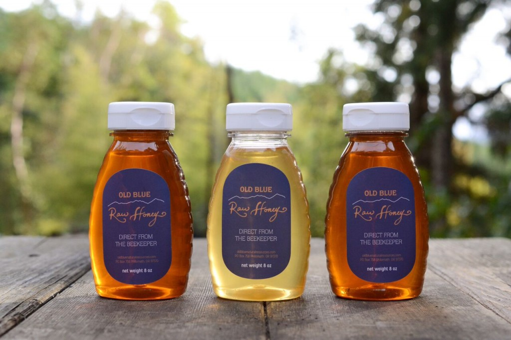 three small bottles of honey