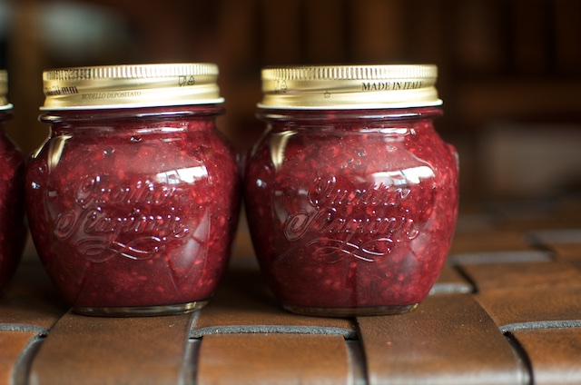 a close up of two jars of low sugar blackberry rhubarb jam
