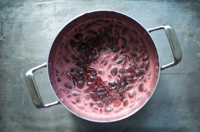 lightly pickled sweet cherries in a stainless pot