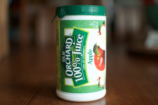 A canister of apple juice concentrate, which is easier to find than white grape juice concentrate.