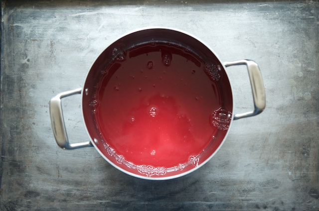 Red currant juice in a pot, soon to become red currant jelly.