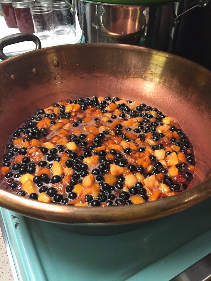 making jam in copper pot