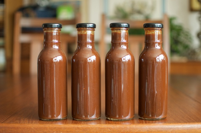 four finished jars of barbecue sauce