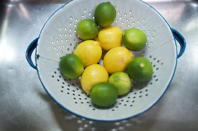 fruit in a colander for lemon lime marmalade