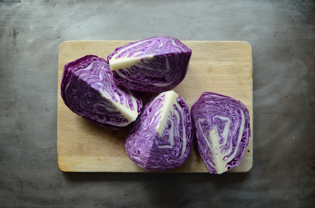 Quartered cabbage for red cabbage apple ginger kraut