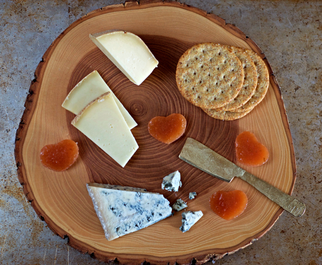 cheese plate with heart shaped apple-quince fruit cheese