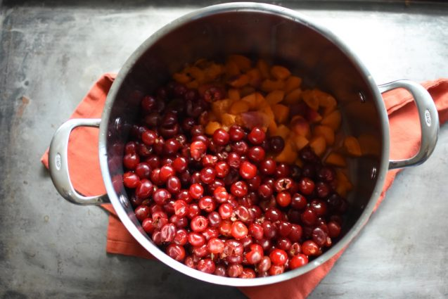 sour cherries and apricots in a pot