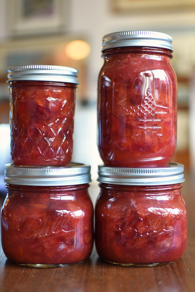 four jars of sour cherry apricot jam