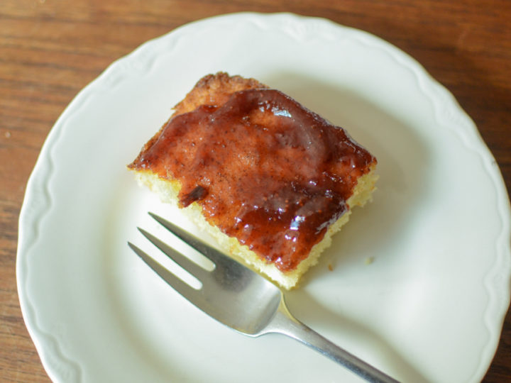 Square of vanilla cake topped with strawberry jam
