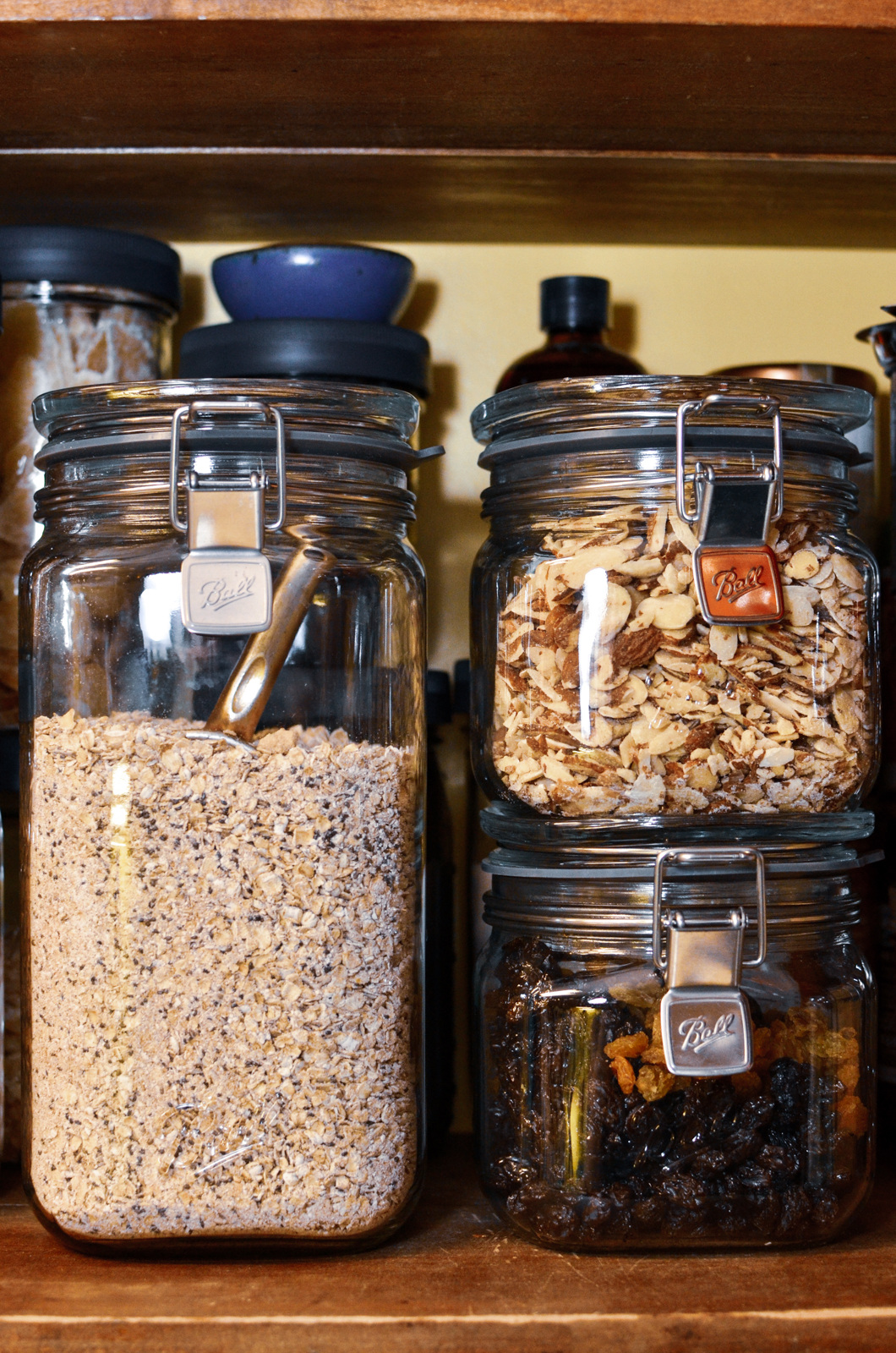 Ball Storage Latch Jars holding homemade instant oats, sliced almonds, and raisins in the pantry.