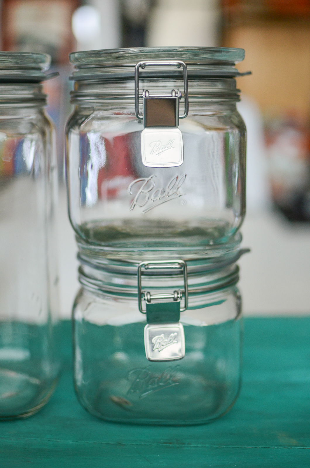 Two empty, stacked smaller sized Ball Storage Latch Jars.
