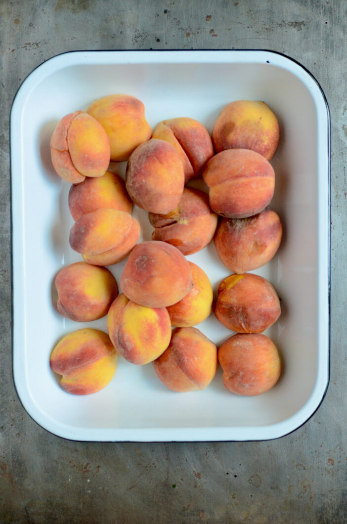 Halved peaches in a baking dish