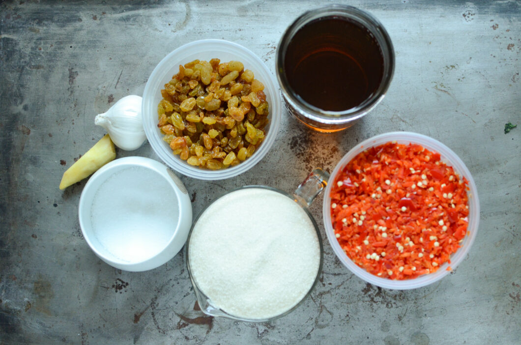 Garlic, ginger, golden raisins, vinegar, chopped peppers, sugar, and salt. These are the ingredients for the chili sauce.
