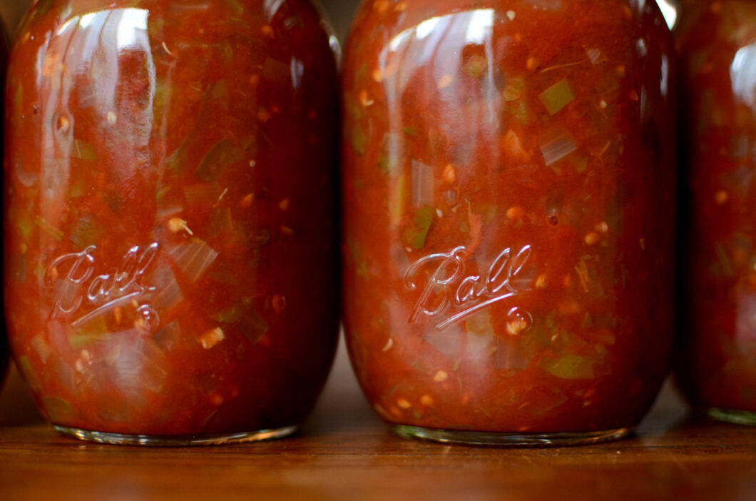 Close of up two finished pint jars of zesty salsa