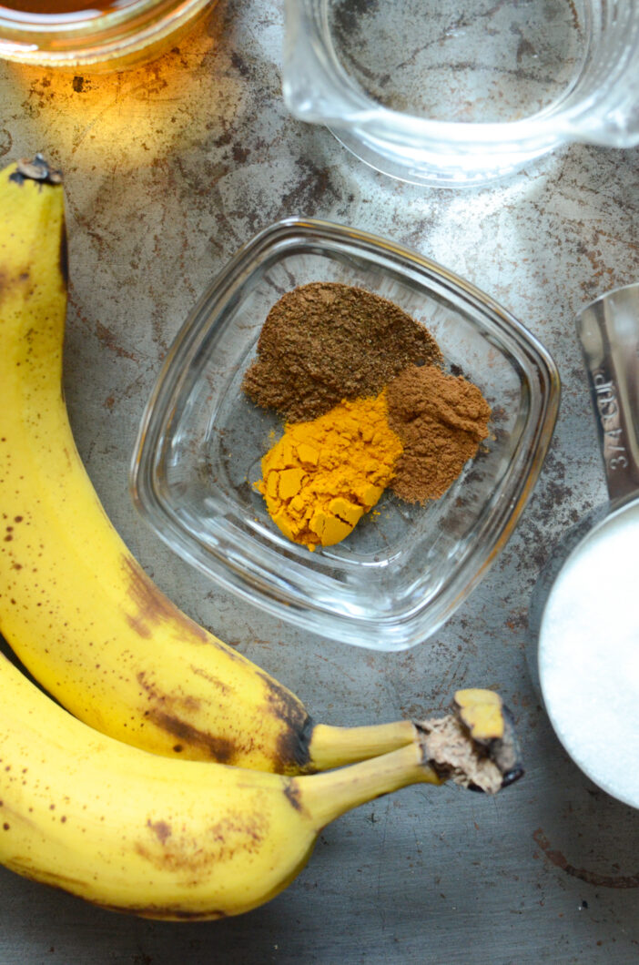 Close up on bananas, spices, and sugar.